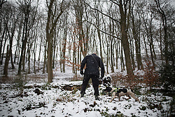 © Licensed to London News Pictures . 17/01/2016 . Rossendale , UK . Police sniffer dog searching forest opposite the scene on Sunny Bank Road , Helmshore , where 60-year-old Sadie Hartley was discovered with multiple stab wounds at her home at 22:40 GMT on Friday (15th January 2016) . Photo credit : Joel Goodman/LNP