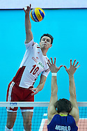 Poland's Mariusz Wlazly (left) spikes the ball while volleyball final match between Brazil and Poland during the 2014 FIVB Volleyball World Championships at Spodek Hall in Katowice on September 21, 2014.<br /> <br /> Poland, Katowice, September 21, 2014<br /> <br /> For editorial use only. Any commercial or promotional use requires permission.<br /> <br /> Mandatory credit:<br /> Photo by © Adam Nurkiewicz / Mediasport