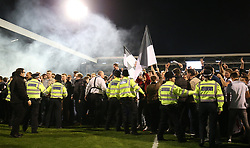 Fulham fans are restrained by police after they invade the pitch after the final whistle - Mandatory by-line: Paul Terry/JMP - 14/05/2018 - FOOTBALL - Craven Cottage - Fulham, England - Fulham v Derby County - Sky Bet Championship Play-off Semi-Final