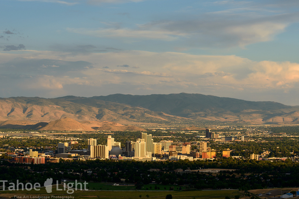 Reno, Nevada, downtown city skyline with casinos and mountains in the background.