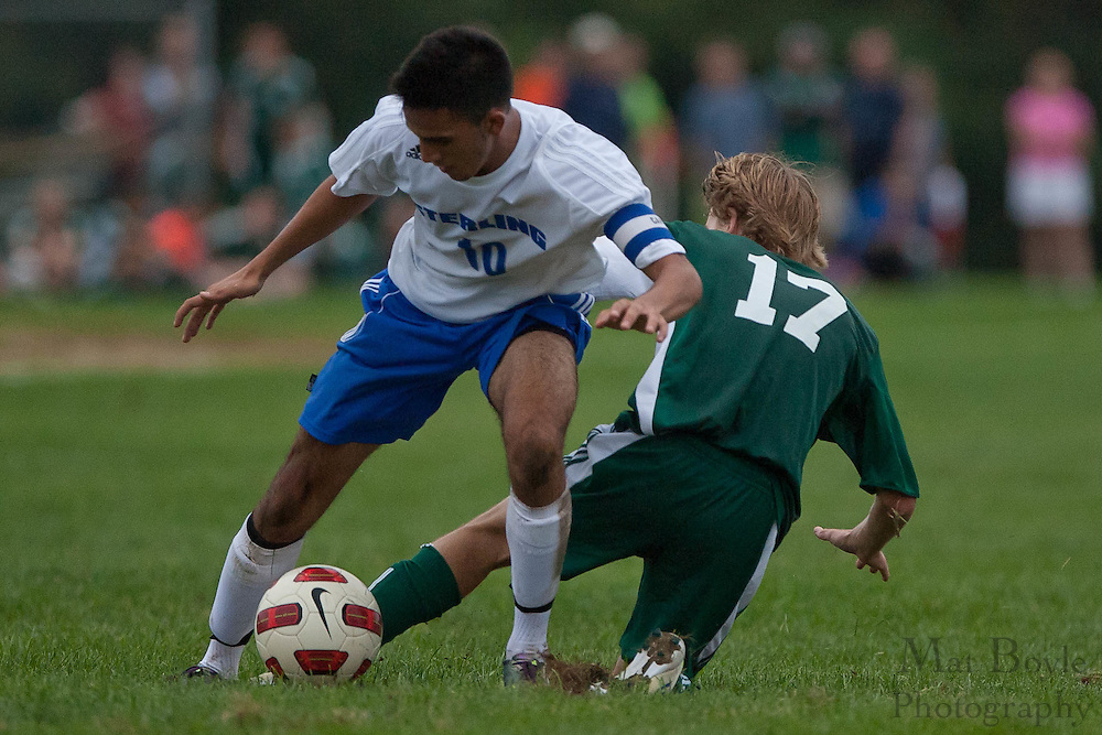 Sterling's Yousif Said gets past West Deptford's Evan Fahey's slide tackle during the first match of the season at Sterling High School on Thursday September 8, 2011.
