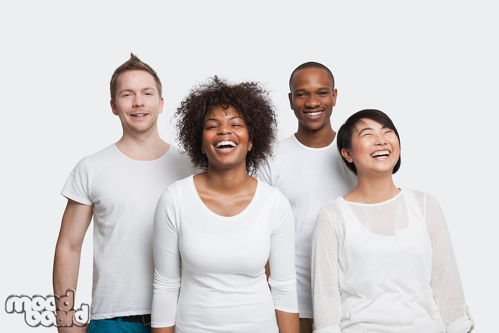 Portrait of cheerful young multi-ethnic friends in casuals over white background