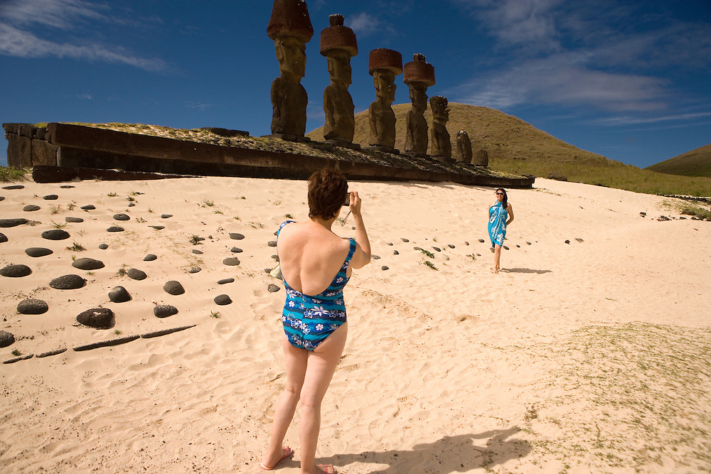 Tourists and moai at Anakena Beach Easter Island, Chile