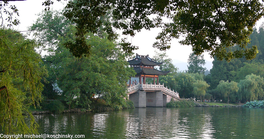 Chinese bridge over pond in parc at Hangzhou