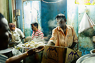a street food vendor in the night market of Mysore, India