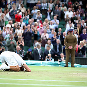 LONDON, ENGLAND - JULY 15: Lucasz Kubot of Poland, on his knees on Center Court, celebrating with Brazil's Marcelo Melo after winning the Men's Doubles Final on Center Court during the Wimbledon Lawn Tennis Championships at the All England Lawn Tennis and Croquet Club at Wimbledon on July 15, 2017 in London, England. (Photo by Tim Clayton/Corbis via Getty Images)