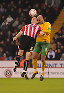 Sheffield - Saturday January 9th, 2009: Chris Morgan of Sheffield United and Antoine Sibierski of Norwich City during the Coca Cola Championship match at Bramall Lane, Sheffield. (Pic by Alex Broadway/Focus Images)