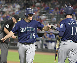 September 12, 2017 - Arlington, TX, USA - The Seattle Mariners' Kyle Seager (15) is congratulated by teammate Mitch Haniger (17) after on scoring a run on a bases-loaded walk by Texas Rangers relief pitcher Jose Leclerc during the seventh inning at Globe Life Park in Arlington, Texas, on Tuesday, Sept. 12, 2017. (Credit Image: © Max Faulkner/TNS via ZUMA Wire)