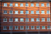 The newly refurbished cell windows of C wing. HMP YOI Winchester was built in 1846 and is typical of the Victorian prison, radial design. It is currently a Category B Local prison that serves the local courts, has an operational capacity of 690 and is able to take men from the age of 18 upwards.  HMP Winchester, Hampshire, United Kingdom. (All image use MUST be credited © prisonimage.org)