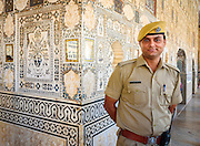 Friendly security oversees the mirrored walls of the Amber Fort, in Jaipur, India. <br /> <br /> Nikon D750 28mm  ISO 1000  f13  1/60s