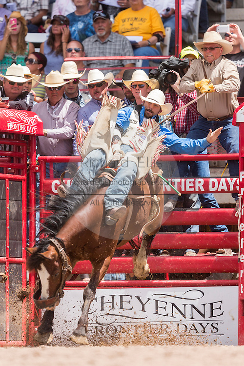 Bareback rider Winn Ratliff holds on to his bronco during the Bareback Championships at the Cheyenne Frontier Days rodeo in Frontier Park Arena July 26, 2015 in Cheyenne, Wyoming. Frontier Days celebrates the cowboy traditions of the west with a rodeo, parade and fair.