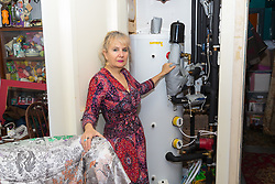 Artist Michelle Baharier, 55, shows how the huge boiler. She is fighting payment demands by Southwark Council the freeholders of her 2 bedroom Camberwell flat, which she purchased in 2008 under the Right to Buy Scheme,  London, November 16 2018.