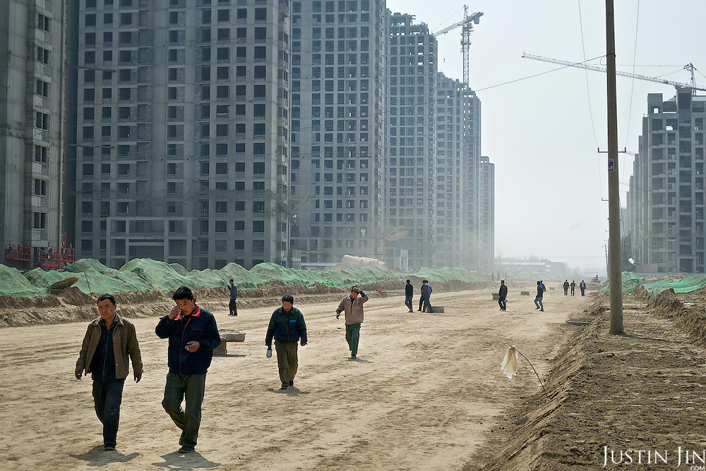 Workers -- themselves farmers made landless a few years earlier -- build a housing block to compensate farmers for their lost land in northern China. <br /> <br /> China is pushing ahead with a dramatic, history-making plan to move 100 million rural residents into towns and cities over six years &mdash; but without a clear idea of how to pay for the gargantuan undertaking or whether the farmers involved want to move.<br />