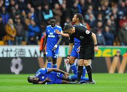 Souleymane Bamba of Cardiff City picks up an injury after colliding with Adama Traore of Wolverhampton Wanderers- Mandatory by-line: Nizaam Jones/JMP - 02/03/2019 - FOOTBALL - Molineux - Wolverhampton, England -  Wolverhampton Wanderers v Cardiff City - Premier League