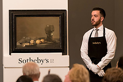 "© Licensed to London News Pictures. 06/07/2016. London, UK.  ""Still life of lemons and olives"" by Pieter Claesz, which sold for a hammer price of GBP 1.5m (est. 1.8-2.5m) at Sotheby's Old Masters evening sale in New Bond Street. Photo credit : Stephen Chung/LNP"
