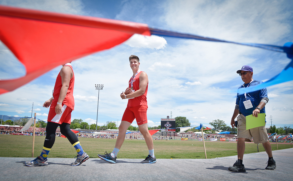mkb051317r/sports/Marla Brose --  Albuquerque Academy's Jackson Morris walks to the podium after winning the javelin finals during NMAA State Track & Field Championships, Saturday, May 13, 2017, in Albuquerque, N.M. (Marla Brose/Albuquerque Journal)