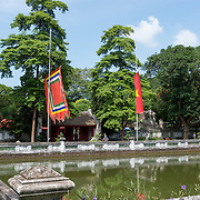Pond surrounded by temple buildings in the grounds of Temple of Literature, Hanoi