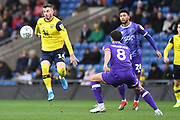 Oxford United midfielder Anthony Forde (14) controls the ball under pressure from Shrewsbury Town midfielder Oliver Norburn (8) during the EFL Sky Bet League 1 match between Oxford United and Shrewsbury Town at the Kassam Stadium, Oxford, England on 7 December 2019.