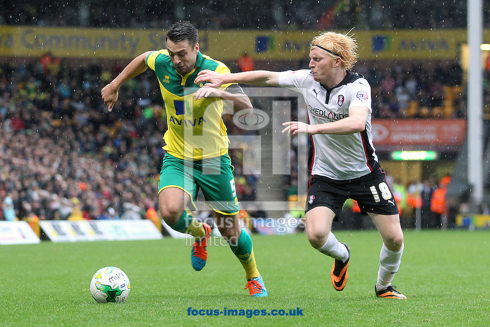 Russell Martin of Norwich and Ben Pringle of Rotherham United in action during the Sky Bet Championship match at Carrow Road, Norwich<br /> Picture by Paul Chesterton/Focus Images Ltd +44 7904 640267<br /> 04/10/2014