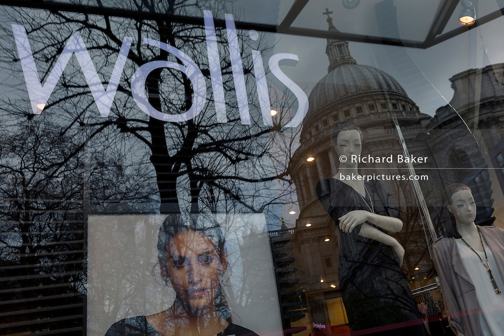 Retail window mannequins for the Wallis brand and the reflection of St. Paul's Cathedral, on 16th February 2017, in the City of London, England.