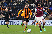Hull City forward Jarrod Bowen (20) battles for possession with Aston Villa midfielder Mile Jedinak (15)  during the EFL Sky Bet Championship match between Hull City and Aston Villa at the KCOM Stadium, Kingston upon Hull, England on 31 March 2018. Picture by Mick Atkins.