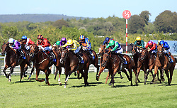 Pretty Baby ridden by jockey Dane O'Neill (yellow jersey) comes homes winning the L'Ormarins Queens Plate Oak Tree Stakes during day four of the Qatar Goodwood Festival at Goodwood Racecourse, Chichester.