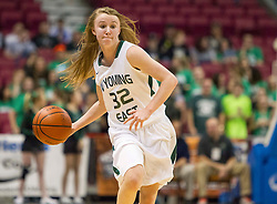 Wyoming East guard Gabby Lupardus (32) launches the ball up the floor to a teammate against Bluefield during a first round game at the Charleston Civic Center.