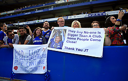 Chelsea fans in the stands with with signs for John Terry and David Luiz