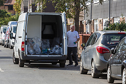 A van contains bags of evidence recovered from the house  where seven-year-old Joel Urhie died in a suspected arson attack on his home in Deptford in the early hours of Tuesday 7th August. London, August 08 2018.