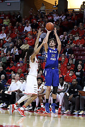 20 January 2017:  Niels Bunschoten takes a shot while defended by Tony Wills(12) during an NCAA Missouri Valley Conference mens basketball game Where the Purple Aces of Evansville lost to the Illinois State Redbirds 75-73 in Redbird Arena, Normal IL