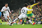 Swansea City midfielder Nathan Dyer (12) tackles Norwich City midfielder Emi Buendía (17) during the EFL Sky Bet Championship match between Norwich City and Swansea City at Carrow Road, Norwich, England on 8 March 2019.