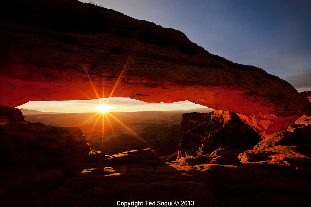 Mesa Arch at sunrise. <br /> The natural stone arch is very popular with photographers located in true Canyonlands National Park, Utah.