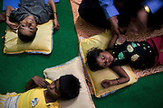 Disabled children are participating to a physiotherapy session inside the Chingari Rehabilitation Centre in Bhopal, Madhya Pradesh, India, near the abandoned Union Carbide (now DOW Chemical) industrial complex. Copyright: Alex Masi / Focus For Humanity