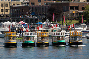 "Tiny harbor taxi ferries perform a synchronized ""Ferry Boat Ballet"" for crowds at the inner harbor during celebrations marking British Columbia Day August 4, 2018 in Victoria, BC, Canada."