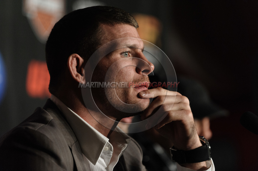 MANCHESTER, ENGLAND, NOVEMBER 12, 2009: Michael Bisping listens to a question fielded by a member of hte press during the pre-fight press conference for UFC 105 at the MEN Arena in Manchester, England on November 12, 2009.