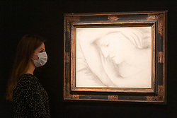 © Licensed to London News Pictures. 23/07/2020. London, UK.  A Sotheby's staff member views a charcoal on primed  canvas artwork titled Femme endormie (1931) by artist Pablo Picasso with an estimate of £6-9 million. Works spanning over half a millennium of art history go on display at Sotheby's London ahead of a one-off auction on July 28. Titled 'Rembrandt to Richter', the sale will offer the very best from Old Masters, Impressionist & Modern Art, Modern & Post-War British Art and Contemporary Art – travelling from the Italian Renaissance through to Pop Art. Photo embargoed for usage until 24th July 2020 09:00. Photo credit: Ray Tang/LNP