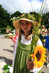 © Licensed to London News Pictures. 11/07/2015. Grasmere, UK. Residents of Grasmere take part in the . Rushbearing festival. Rushbearing is an old English ecclesiastical festival in which rushes are collected and carried to be strewn on the floor of the parish church. <br /> The tradition dates back to the time when most buildings had earthen floors and rushes were used as a form of renewable floor covering for cleanliness and insulation. <br /> The festival was widespread in Britain from the Middle Ages and well established by the time of Shakespeare, but had fallen into decline by the beginning of the 19th century, as church floors were flagged with stone.<br /> Photo credit : Martin Campbell/LNP