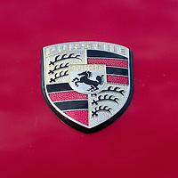 PADOVA, ITALY - OCTOBER 27:  A traditional Porsche logo is  seen on a vintage car on display on October 27, 2011 in Padova, Italy. The Vintage and Classic Cars Exhibition of Padova, running from the October 28 - 30, is the most important European trade show for vintage cars and motorbikes, showcasing over 1600 vehicles.