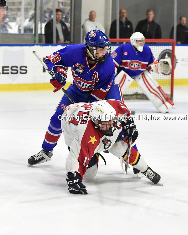 BUFFALO, NY - SEP 20,  2017: Ontario Junior Hockey League Governors Showcase game between the Toronto Jr. Canadiens and Wellington Dukes, Jack McBain #19 of the Toronto Jr. Canadiens battles for control with Colin Doyle #17 of the Wellington Dukes during the second period.<br /> (Photo by Andy Corneau / OJHL Images)