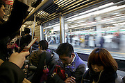 Tokyo young adults during there commute to and from work