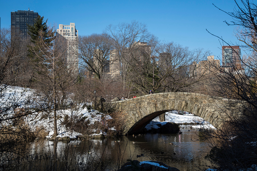 The beautiful, schist Gapstow Bridge over northeast end of The Pond, Central Park, Manhattan, New York City, New York, United States of America.  The bridge is famous for offering one of the best views of the city skyline. Central Park is covered in snow.  (photo by Andrew Aitchison / In pictures via Getty Images)