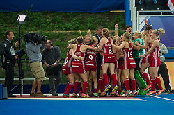 England players celebrate after beating The Netherlands with Matthew Pinsent. England v The Netherlands - Final Unibet EuroHockey Championships, Lee Valley Hockey & Tennis Centre, London, UK on 30 August 2015. Photo: Simon Parker