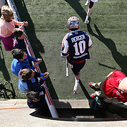 Stephen Berger #10 of the Boston Cannons runs onto the field prior to the game at Harvard Stadium on May 17, 2014 in Boston, Massachuttes. (Photo by Elan Kawesch)