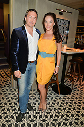 Left to right, dancer KATYA VIRSHILAS and her husband KLAUS KONGSDAL at Henry Conway's 31st birthday party held at the Pont St Restaurant, Belgraves Hotel, London on 12th July 2014.