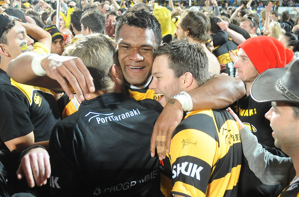 Taranaki's Seta Tamanivalu celebrates with fans after his teams defeat over the Tasman Makos in the ITM Cup Rugby Premiership final match at Yarrow Stadium, New Plymouth, New Zealand, Saturday, October 25, 2014. Credit:SNPA / Ross Setford
