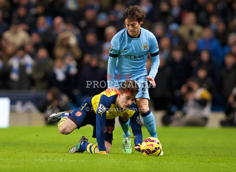 MANCHESTER, ENGLAND - Sunday, January 18, 2015: Manchester City's David Silva in action against Arsenal's Hector Bellerin during the Premier League match at the City of Manchester Stadium. (Pic by David Rawcliffe/Propaganda)