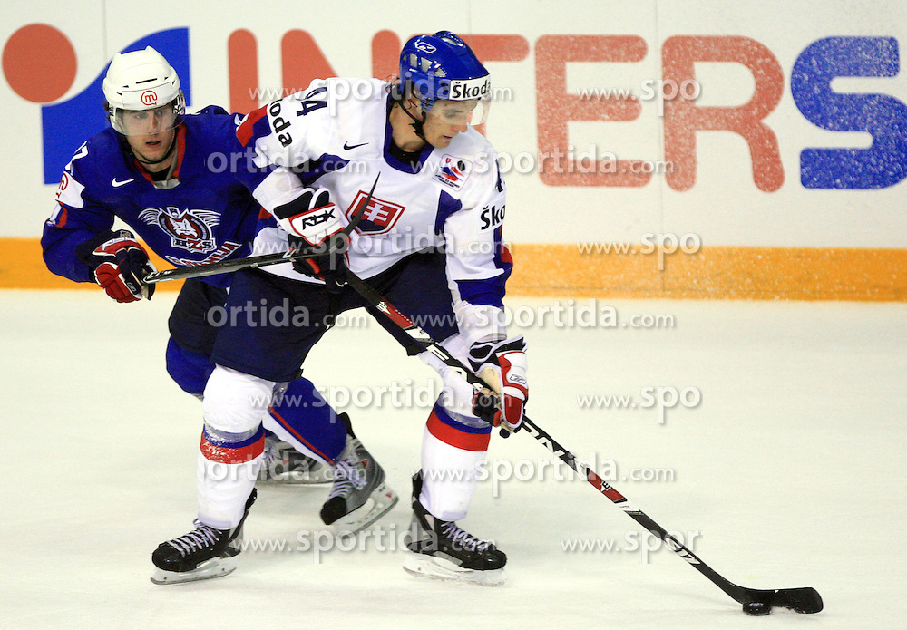 Mitja Robar of Slovenia and Andrej Sekera of Slovakia at ice-hockey game Slovenia vs Slovakia at second game in  Relegation  Round (group G) of IIHF WC 2008 in Halifax, on May 10, 2008 in Metro Center, Halifax, Nova Scotia, Canada. Slovakia won after penalty shots 4:3.  (Photo by Vid Ponikvar / Sportal Images)