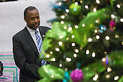 Former Neurosurgeon and Republican presidential candidate Dr. Ben Carson views the Christmas tree set up in the lounge of MUSC Children's Hospital December 22, 2015 in Charleston, South Carolina. Carson stopped by to listen to Christmas carols and greet the young patients.