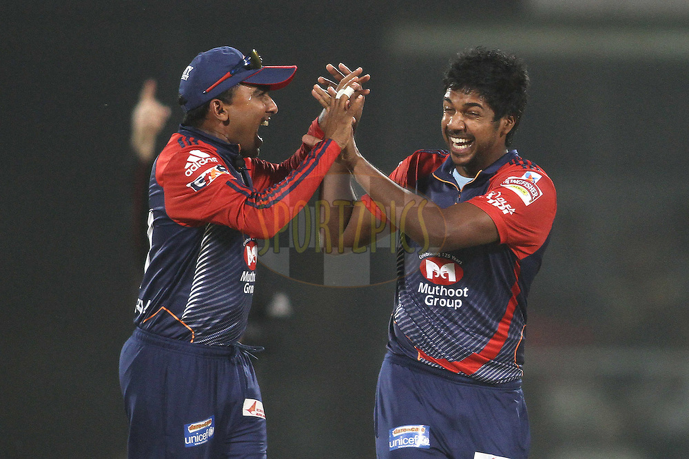 Mahela Jayawardene of the Delhi Daredevils congratulates Varun Aaron of the Delhi Daredevils on getting Shaun Marsh of the Kings XI Punjab wicket during match 64 of the the Indian Premier League (IPL) 2012  between The Delhi Daredevils and the Kings XI Punjab held at the Feroz Shah Kotla, Delhi on the 15th May 2012..Photo by Shaun Roy/IPL/SPORTZPICS