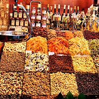 Mixed Dried Fruit, Nuts, Grains and Olive Oil at La Boqueria Market in Barcelona, Spain<br />